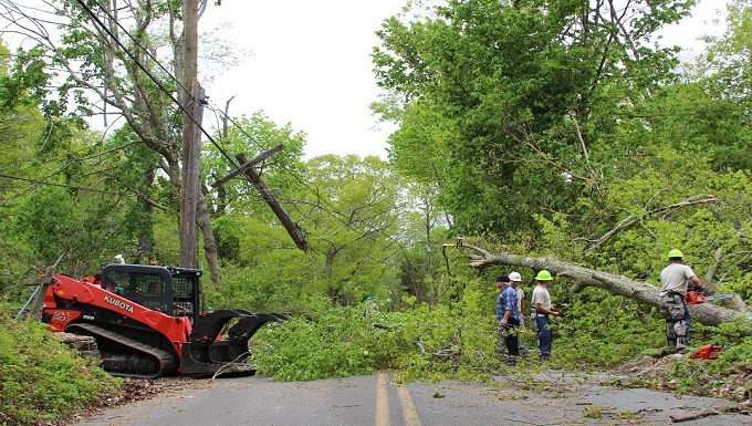 103rd Civil Engineers clear roads after storm